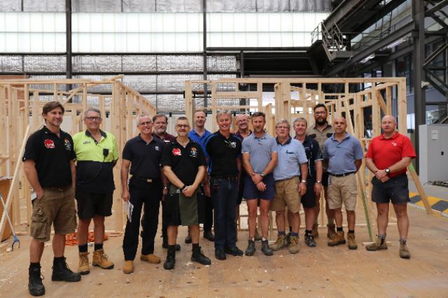 A team of carpentry teachers